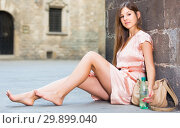 Купить «young girl in romantic dress sitting in town», фото № 29899040, снято 26 августа 2017 г. (c) Яков Филимонов / Фотобанк Лори