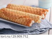 Купить «Gaufres de Montcuq, rolled wafers with cream filling», фото № 29909712, снято 14 января 2019 г. (c) Stockphoto / Фотобанк Лори