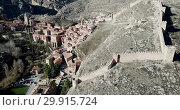 Купить «Defensive Northern wall of Albarracin on background of cityscape with Cathedral tower, Aragon, Spain», видеоролик № 29915724, снято 26 декабря 2018 г. (c) Яков Филимонов / Фотобанк Лори