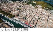 Купить «Aerial view from drone of channel with boats and historic center of Beaucaire, France», видеоролик № 29915908, снято 24 октября 2018 г. (c) Яков Филимонов / Фотобанк Лори