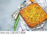Potato kugel gratin in a glass pan. Стоковое фото, фотограф Марина Сапрунова / Фотобанк Лори