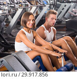 Well trained positive young man and woman training abdominal muscles in gym. Стоковое фото, фотограф Яков Филимонов / Фотобанк Лори