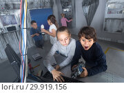 Купить «children play in the quest room of a inscrutable bunker», фото № 29919156, снято 21 октября 2017 г. (c) Яков Филимонов / Фотобанк Лори