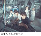 Купить «Children playing in bunker questroom», фото № 29919164, снято 21 октября 2017 г. (c) Яков Филимонов / Фотобанк Лори