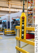Купить «Remote control pendant switch for overhead crane in the factory», фото № 29919776, снято 28 сентября 2018 г. (c) Андрей Радченко / Фотобанк Лори