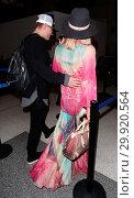 Купить «Paris Hilton departs from Los Angeles International Airport (LAX) with her fiancé Chris Zylka Featuring: Paris Hilton, Chris Zylka Where: Los Angeles,...», фото № 29920564, снято 24 января 2018 г. (c) age Fotostock / Фотобанк Лори