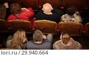 Купить «Theatre hall. People waiting for the performance and sitting in their phones», видеоролик № 29940664, снято 22 марта 2019 г. (c) Константин Шишкин / Фотобанк Лори