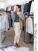 Купить «Woman trying new jacket in clothing store», фото № 29942708, снято 10 октября 2018 г. (c) Яков Филимонов / Фотобанк Лори