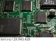 Купить «St.Petersburg, Russia - April 2018 -Printed circuit board. Computer technology background.», фото № 29943428, снято 13 апреля 2018 г. (c) Мельников Дмитрий / Фотобанк Лори