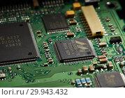 Купить «St.Petersburg, Russia - April 2018 -Printed circuit board. Computer technology background.», фото № 29943432, снято 13 апреля 2018 г. (c) Мельников Дмитрий / Фотобанк Лори