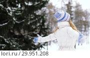 Купить «happy young woman in winter forest», видеоролик № 29951208, снято 31 января 2019 г. (c) Syda Productions / Фотобанк Лори