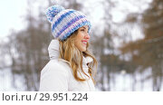 Купить «portrait of happy smiling woman outdoors in winter», видеоролик № 29951224, снято 31 января 2019 г. (c) Syda Productions / Фотобанк Лори