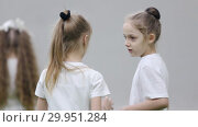 Купить «Indoor football arena. Two little girls talking and one girl give the ball to another», видеоролик № 29951284, снято 26 марта 2019 г. (c) Константин Шишкин / Фотобанк Лори