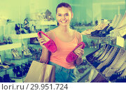 Купить «girl choosing pair of shoes in boutique», фото № 29951724, снято 15 сентября 2016 г. (c) Яков Филимонов / Фотобанк Лори