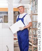 Купить «Contractor installing ceramic tile», фото № 29951796, снято 28 мая 2018 г. (c) Яков Филимонов / Фотобанк Лори