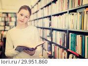 Купить «tweenager girl reading interesting book in bookstore», фото № 29951860, снято 22 февраля 2018 г. (c) Яков Филимонов / Фотобанк Лори