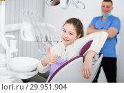 Купить «Girl patient in dental office showing ok gesture», фото № 29951904, снято 1 марта 2018 г. (c) Яков Филимонов / Фотобанк Лори
