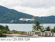 Купить «Plane Tigerair landing approach», фото № 29959124, снято 29 ноября 2016 г. (c) Игорь Жоров / Фотобанк Лори