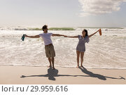 Купить «Romantic happy young couple with arms outstretched and holding hands», фото № 29959616, снято 6 ноября 2018 г. (c) Wavebreak Media / Фотобанк Лори