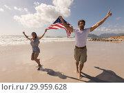 Купить «Happy young couple with arms outstretched holding american flag », фото № 29959628, снято 6 ноября 2018 г. (c) Wavebreak Media / Фотобанк Лори