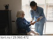 Купить «Female doctor discussing medical report with disable senior woman on digital tablet», фото № 29960472, снято 22 ноября 2018 г. (c) Wavebreak Media / Фотобанк Лори