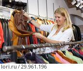 Купить «Woman choosing leather jacket», фото № 29961196, снято 5 сентября 2018 г. (c) Яков Филимонов / Фотобанк Лори