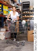 Купить «Female with purchases in build store», фото № 29961220, снято 20 сентября 2018 г. (c) Яков Филимонов / Фотобанк Лори