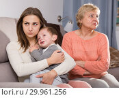 Купить «Two women are quarreling for upbringing toddler», фото № 29961256, снято 15 февраля 2018 г. (c) Яков Филимонов / Фотобанк Лори
