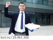 Купить «Smiling manager is happy after successful signing contract», фото № 29961308, снято 3 июня 2017 г. (c) Яков Филимонов / Фотобанк Лори