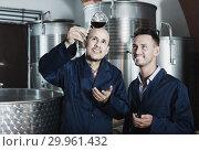 Купить «two workers on wine factory», фото № 29961432, снято 21 августа 2019 г. (c) Яков Филимонов / Фотобанк Лори