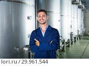 Купить «Portrait of man winery worker on wine factory in secondary fermentation section», фото № 29961544, снято 13 декабря 2019 г. (c) Яков Филимонов / Фотобанк Лори