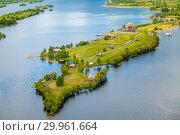 Купить «Aerial view of Kizhi island with old russian wooden architecture in Karelia. Summer sunny day.», фото № 29961664, снято 9 июня 2018 г. (c) Сергей Цепек / Фотобанк Лори