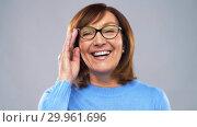 Купить «portrait of happy senior woman in glasses», видеоролик № 29961696, снято 11 февраля 2019 г. (c) Syda Productions / Фотобанк Лори