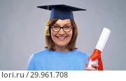Купить «happy senior graduate student woman with diploma», видеоролик № 29961708, снято 11 февраля 2019 г. (c) Syda Productions / Фотобанк Лори