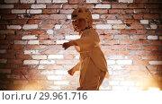 Купить «Training studio. Martial arts. Little girl training her karate skills. Turns around and kicking the air», видеоролик № 29961716, снято 8 июля 2020 г. (c) Константин Шишкин / Фотобанк Лори