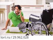 Купить «Young handsome man in wheelchair at home», фото № 29962028, снято 14 ноября 2018 г. (c) Elnur / Фотобанк Лори