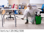Купить «Professional contractor doing pest control at office», фото № 29962508, снято 16 ноября 2018 г. (c) Elnur / Фотобанк Лори