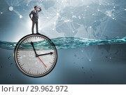 Купить «Businessman in deadline and time management concept», фото № 29962972, снято 19 марта 2019 г. (c) Elnur / Фотобанк Лори