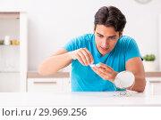 Купить «Man trying contact lenses at home», фото № 29969256, снято 6 августа 2018 г. (c) Elnur / Фотобанк Лори