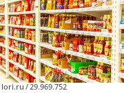 Купить «Russia, Samara, January 2019: a large selection of ketchup and seasonings and sauce in a large supermarket.», фото № 29969752, снято 16 января 2019 г. (c) Акиньшин Владимир / Фотобанк Лори