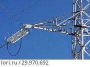 Купить «Опора ЛЭП с высоковольтными проводами на фоне голубого неба», фото № 29970692, снято 30 января 2010 г. (c) Александр Гаценко / Фотобанк Лори