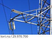 Купить «Опора ЛЭП с высоковольтными проводами на фоне голубого неба», фото № 29970700, снято 30 января 2010 г. (c) Александр Гаценко / Фотобанк Лори