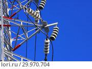 Купить «Опора ЛЭП с высоковольтными проводами на фоне голубого неба», фото № 29970704, снято 28 февраля 2010 г. (c) Александр Гаценко / Фотобанк Лори
