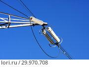 Купить «Опора ЛЭП с высоковольтными проводами на фоне голубого неба», фото № 29970708, снято 30 января 2010 г. (c) Александр Гаценко / Фотобанк Лори