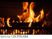Купить «Fireplace with a bright flame, close-up», фото № 29976684, снято 26 января 2019 г. (c) EugeneSergeev / Фотобанк Лори