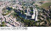 Купить «Aerial view of Carcassonne cityscape with medieval fortress of Cite de Carcassonne, Aude, Occitanie, France», видеоролик № 29977048, снято 6 октября 2018 г. (c) Яков Филимонов / Фотобанк Лори