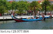 Купить «Aveiro Water Canal with gondola boats. Portugal.», видеоролик № 29977864, снято 8 мая 2018 г. (c) Serg Zastavkin / Фотобанк Лори