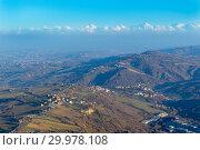 Купить «Beautiful view from San Marino city to hills of San Marino. Italian hills view from above», фото № 29978108, снято 2 января 2019 г. (c) Григорий Стоякин / Фотобанк Лори