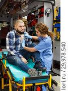 Купить «Paramedic team providing first aid to man», фото № 29978540, снято 30 ноября 2018 г. (c) Яков Филимонов / Фотобанк Лори