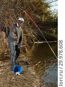 Купить «Man and pulling fish near river», фото № 29978608, снято 27 января 2019 г. (c) Яков Филимонов / Фотобанк Лори
